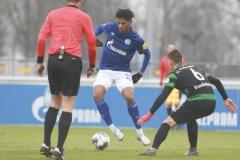 Testspiel FC Schalke 04 -  Preußen Münster 18.01.2020 Foto: S. Sanders  Schiedsrichter Florian Exner, Jean-Clair Todibo, Nico Brandenburger (Münster)